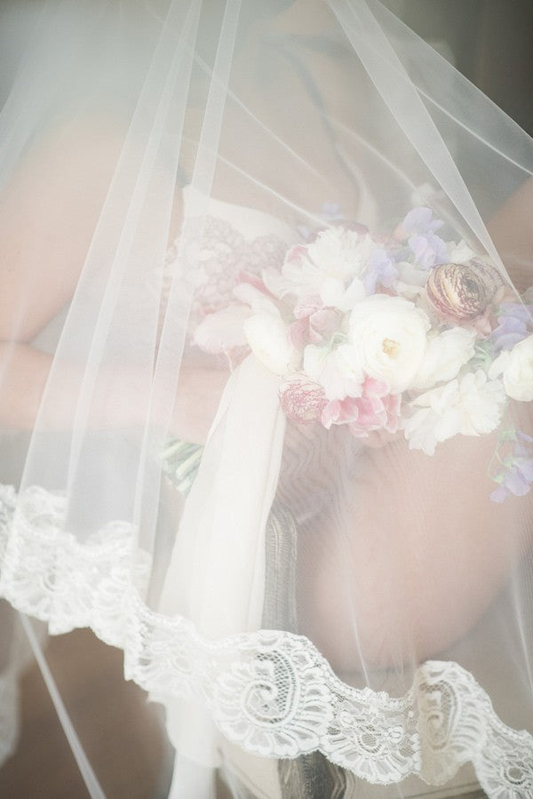 boudior bridal photo shoot with mantilla wedding veil and bouquet