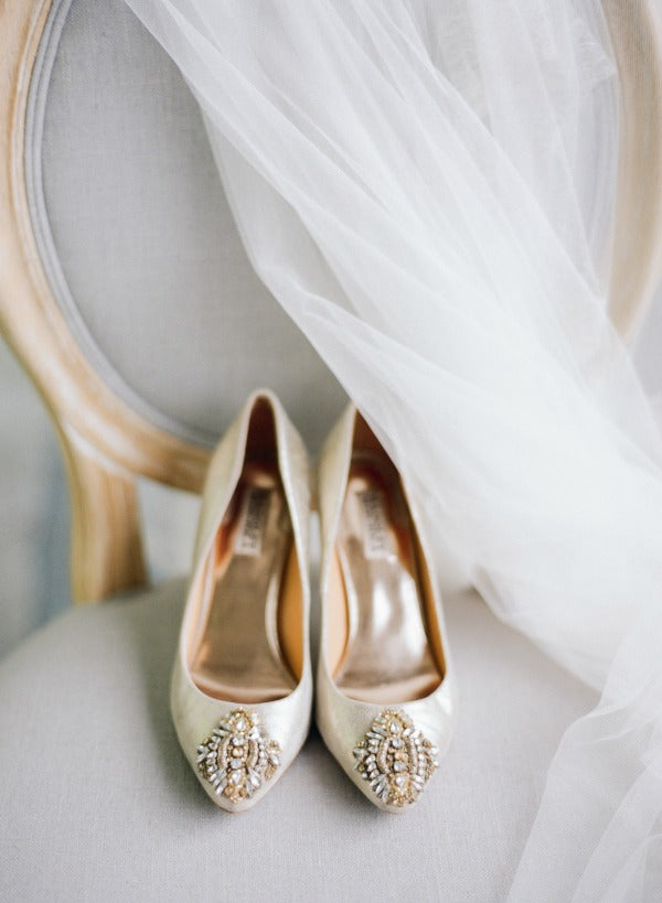 gold wedding shoes on chair