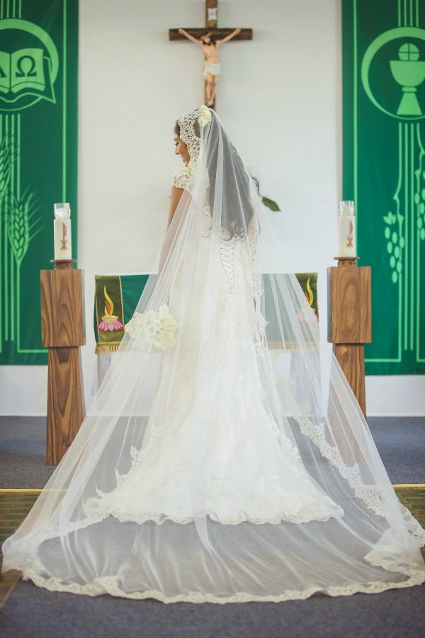 hawaiian wedding in catholic church with cathedral length mantilla veil