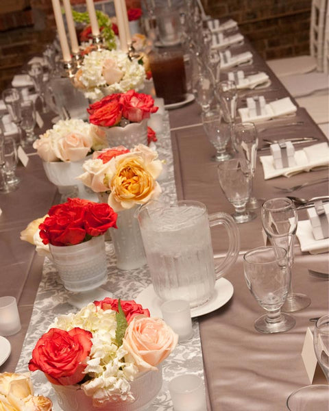 silver table runner and garden roses