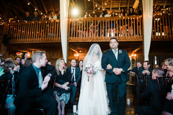 rustic wedding bride walking down the aisle cathedral veil from The Mantilla Company