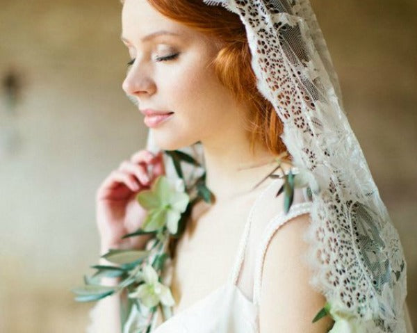 bohemian bride in mantilla veil and garland