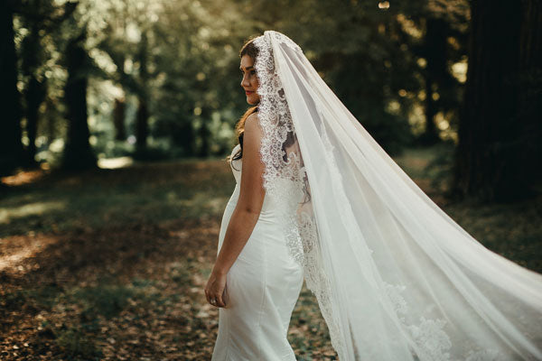 bridal portraits in the woods with long wedding veil