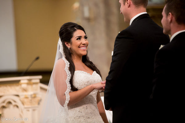 Bride in cathedral length mantilla veil from The Mantilla Company