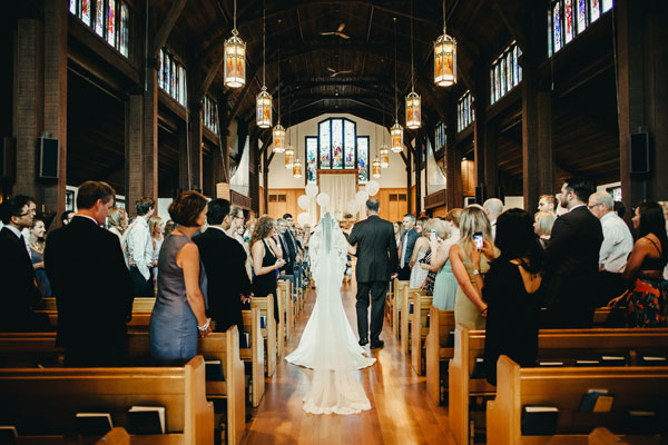 cathedral wedding with long cathedral mantilla veil