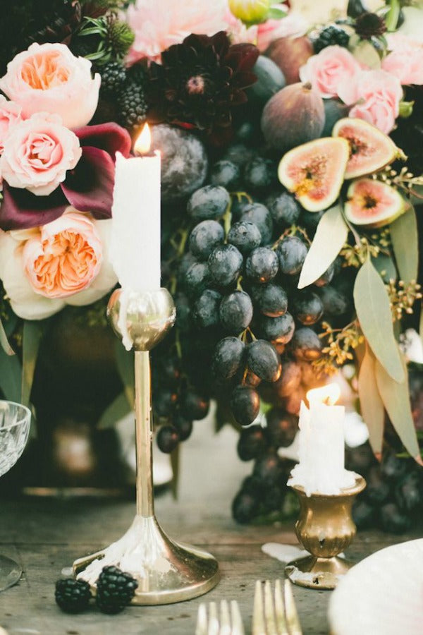 fig and gold summer wedding table setting with candlesticks
