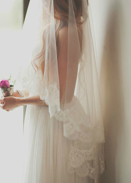 mantilla style fingertip length veil with blusher