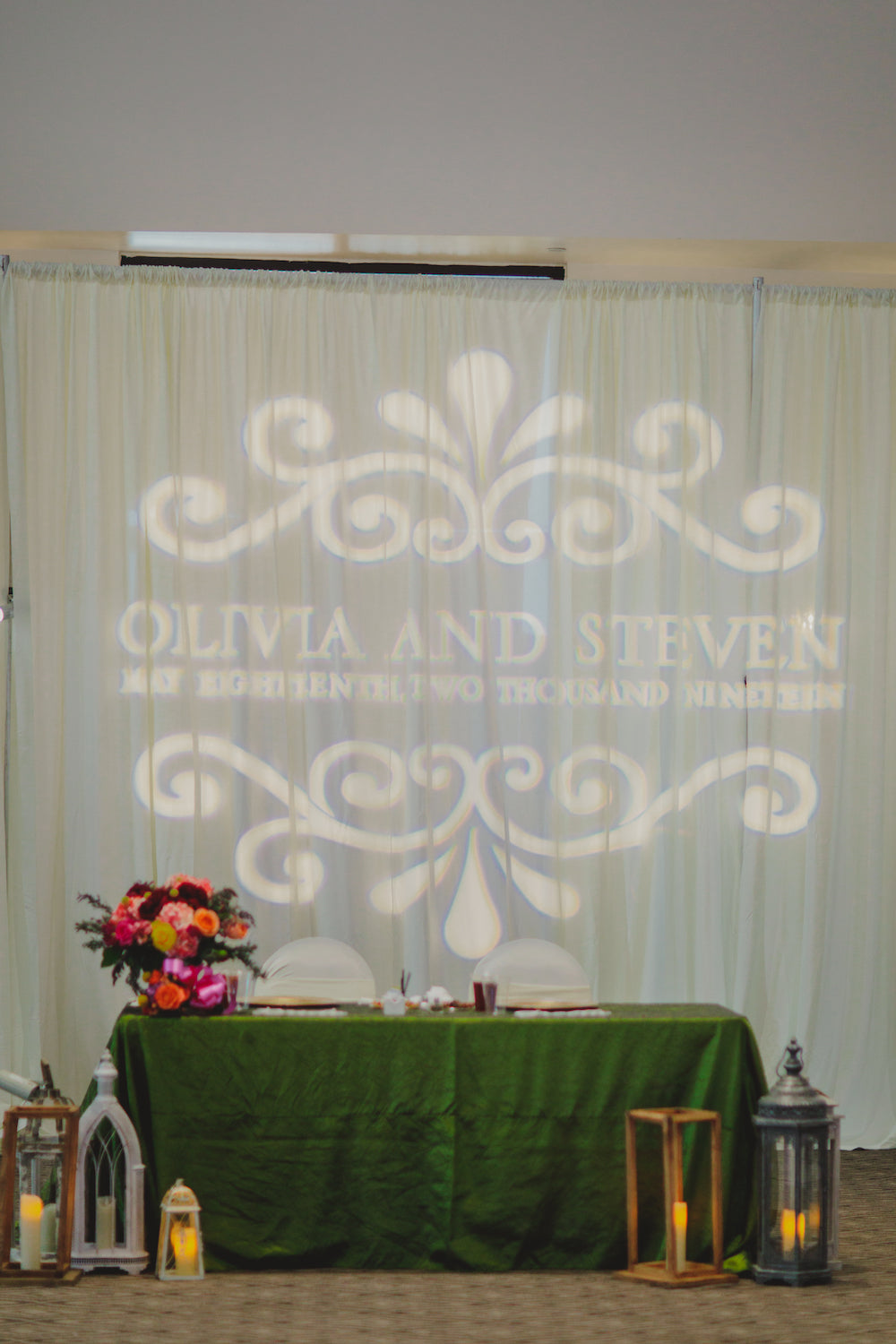 green bride and groom couples table