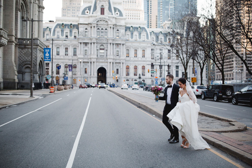 bride and groom crossing the street downtown philadelphia wedding