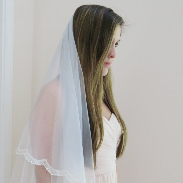 beaded mantilla veil scalloped lace trim cathedral length with blusher pulled back
