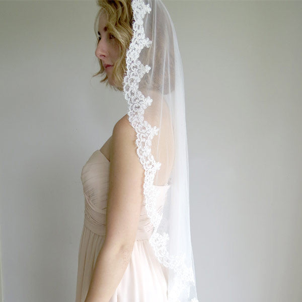 Finger tip length mantilla wedding veil with french alencon lace