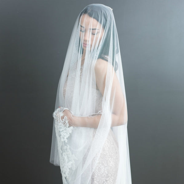 half-lace mantilla veil with blusher over face