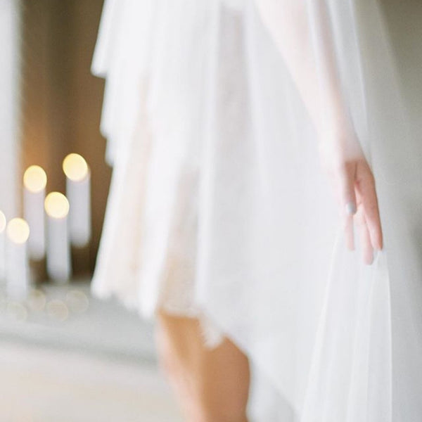 raw edge cathedral veil in ivory with candles