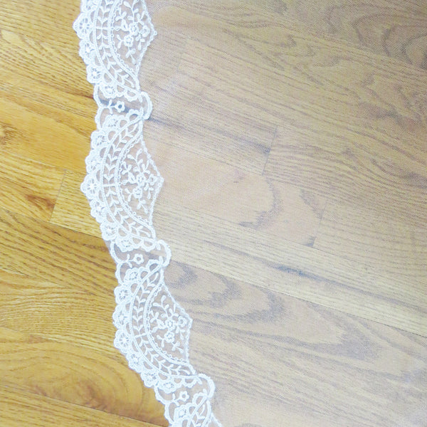 Spanish lace veil in ivory detail of scallop shaped lace