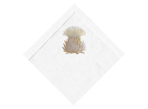 Gold Artichoke on white napkin