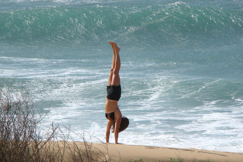 Elaine O'Rourke handstand on beach in hawaii