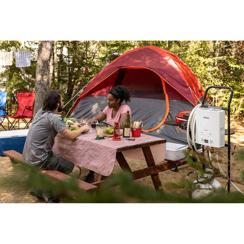 Couple having Picnic and using Onsen 5L Portable Propane Water Heater