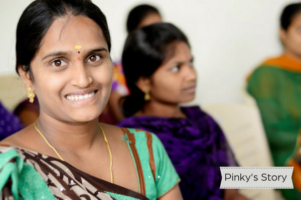 Young Indian woman in classroom smiling