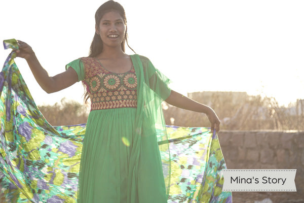 Young Indian woman wearing green dress and dancing in sunlight