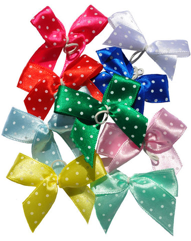 Dog hairbows with white polka dots in assorted colors
