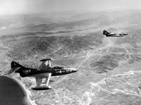 Two F9F Panther jets over and around Wonsan, Korea. Both jets are from USS BOXER (CV-21). Over Wonsan and heading for Togwon.<br>1951