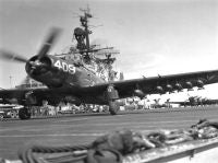 AD loaded with bombs, takes off from the USS BOXER.<br>1953