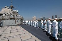 U.S. Navy Sailors from the Ticonderoga Class Guided Missile Cruiser (Aegis) USS BUNKER HILL (CG 52) man the rails as they depart Naval Station San Diego, Calif., on Sept. 13, 2006 for a scheduled Western Pacific deployment as part of Expeditionary Strike Group 5 - 2006 San Diego, CA