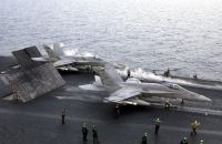 A US Navy (USN) F/A-18 Hornet aircraft assigned to Strike Fighter Squadron 137 (VFA-137) (foreground) and a US Marine Corps (USMC) F/A-18 Hornet from Marine Strike Fighter Squadron Three Two Three (VMFA-323), prepare to launch from the flight deck on board the aircraft carrier USS CONSTELLATION (CV 64). The Constellation and Carrier Air Wing 2 (CVW-2) are deployed conducting combat missions in support of Operation IRAQI FREEDOM. <br>- 2003