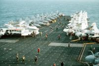 Flight deck crewmen and aircraft maintenance personnel aboard the aircraft carrier USS CONSTELLATION (CV 64) secure from flight quarters during PACEX '89.<br>- 1989