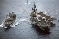 The aircraft carrier USS CORAL SEA (CV 43) is refueled while underway by the fleet oiler USS WACCAMAW (T-AO 109)