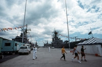 Local residents prepare to visit the guided missile cruiser USS DALE (CG-19) on the station's opening day, 06/25/1990