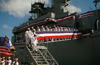Crew members of the guided missile cruiser USS DALE (CG-19)begin to disembark the vessel for the last time near the conclusion of the ship's decommissioning ceremony, 09/22/1994