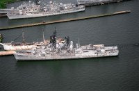 An aerial sided view of two Forest Sherman class destroyers tied up at the Baltimore Fairfield Terminal awaiting scrapping. On the inboard side is the destroyer FORREST SHERMAN (DD-931) and outboard is the BLANDY (DD-943).<br>August 1994