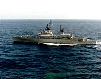 An aerial port beam view of the Belknap class guided missile cruiser USS FOX (CG 33) underway. - 1985