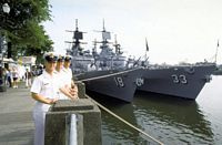Canadian Navy midshipmen pose in front of U.S. Pacific Fleet guided missile cruisers USS WORDEN (CG-18) and USS FOX (CG-33) during Portland's annual Rose Festival. - 1991