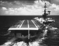 View of the stern of the USS FRANKLIN D. ROOSEVELT (CVA 42) as an approaching aircraft would see it while underway in the Mediterranean Sea. Exact date shot unknown, shot between January 2, 1970 through July 16, 1975.