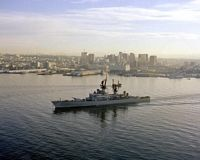 An aerial port bow view of the guided missile cruiser USS HALSEY (CG-23) as it departs. - 1984 San Diego, CA