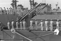 Officers and crewmen man the rails aboard the guided missile cruiser USS HARRY E. YARNELL (CG-17) as they wait for the arrival of three Soviet navy ships. Behind them is a Mark 10 twin missile launcher fitted with two RIM-67B Standared SM-2 ER surface-to-air missiles. The guided missile cruiser MARSHAL USTINOV, the guided missile destroyer OTLICHNYY and the replenishment oiler GENRIKH GASANOV will be making a five-day goodwill visit to the naval station, 07/21/1989