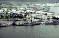 A view of the guided missile cruiser USS WILLIAM H. STANDLEY (CG-32), left, the guided missile destroyer USS HENRY B. WILSON (DDG-7) and the guided missile cruiser USS STERETT (CG-31) docked at a pier.
