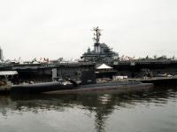 The guided missile submarine ex-USS GROWLER (SSG 577) is moored alongside the Intrepid Sea-Air-Space Museum during Fleet Week activities. <br>1989