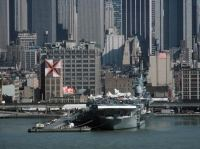 A stern view of the aircraft carrier USS INTREPID (CV 11), now a memorial, during the International Naval Review.<br>1986