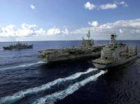 The USNS RAPPAHANNOCK (T-AO 204) (left), the USS KITTY HAWK (CV 63) (center) and USNS 