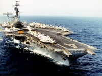 A starboard bow view of the aircraft carrier USS MIDWAY (CV-41) underway.