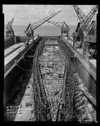 USS Newport News CA-148 under construction in 1946.  Bow view looking aft.