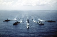 Bow view of the ships comprising the Standing Naval Force Atlantic underway. The ships are from left to right: FGS AUGSBURG (F-222), USS SELLERS (DDG-11), HNLMS VAN NES (F-805), HMCS IROQUOIS (DDH-280) and HMS DANAE (F-47).<br>September 1982