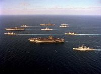 Ten ships of Task Force 155 gather during Operation Desert Storm. Leading the formation at left is the aircraft carrier USS SARATOGA (CV-60), flanked by the guided missile cruisers USS SAN JACINTO (CG-56), top, and USS THOMAS S. GATES (CG-51). At center is the nuclear-powered guided missile cruiser USS MISSISSIPPI (CGN-40) flanked by the aircraft carriers USS AMERICA (CV-66), top, and USS JOHN F. KENNEDY (CV-67). At rear are, from top, the guided missile destroyer USS PREBLE (DDG-46), the guided missile cruisers USS PHILIPPINE SEA (CG-58) and USS NORMANDY (CG-60) and the guided missile destroyer USS WILLIAM V. PRATT (DDG-44). - 1991