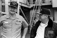 """Secretary of the Navy H. Lawrence Garrett III converses with CAPT M.C. Foote, Commanding Officer of the guided missile cruiser USS TICONDEROGA (CG-47) while visiting the ship during Fleet Ex 1-90. - 1990"