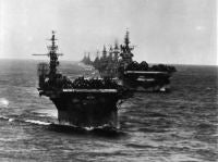 Task Group 38.3 enter Ulithi anchorage after strikes against the Japanese in the Philippines. Seen are the USS LANGLEY (CVL-27), USS TICONDEROGA (CV-14), USS WASHINGTON (BB-56), USS NORTH CAROLINA (BB-55), USS SOUTH DAKOTA (BB-57), USS SANTA FE (SSN-763), USS BILOXI (CL-80), USS MOBILE (CL-63), and the USS OAKLAND (CL-95). <br>1944
