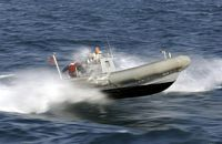 A Rigid Hull Inflatable Boat (RHIB) from USS Valley Forge (CG 50) moves into position to receive the Visit, Board, Search and Seizure (VBSS) inspection team, Jan. 15, 2003. USS Valley Forge (CG 50) is currently forward deployed and is conducting Maritime Interdiction Operations (MIOs) in the Central Command AOR in support of UN sanctions on Iraq. - 2003 Bahrain