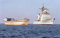 The US Navy TICONDEROGA CLASS, GUIDED MISSILE CRUISER, USS VALLEY FORGE (CG 50) approaches along-side a commercial vessel during Operation MARITIME INTERCEPT. Visit, Board, Search, and Seizure (VBSS) Teams onboard the Valley Forge inspected vessels suspected of violating United Nations Sanctions against Iraq. - 1996